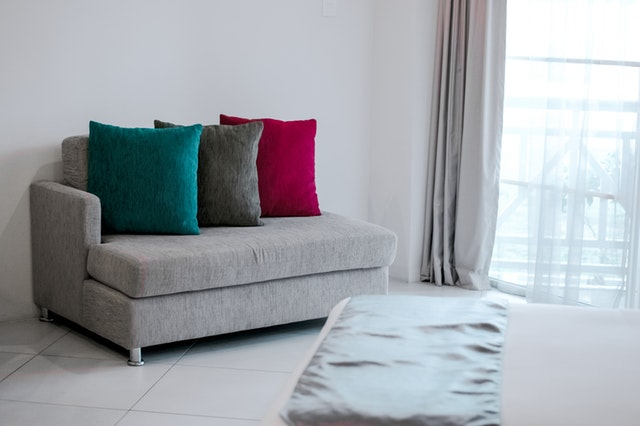 couch with brightly colored pillows