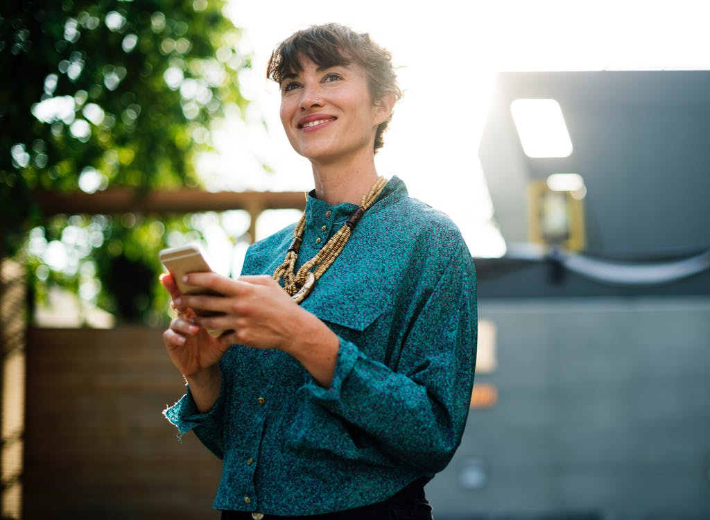 woman smiling on iphone